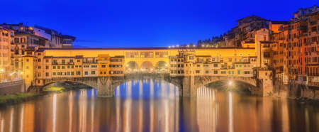 trinita: View of medieval stone bridge Ponte Vecchio and the Arno River from the Ponte Santa Trinita in Florence, Tuscany, Italy.