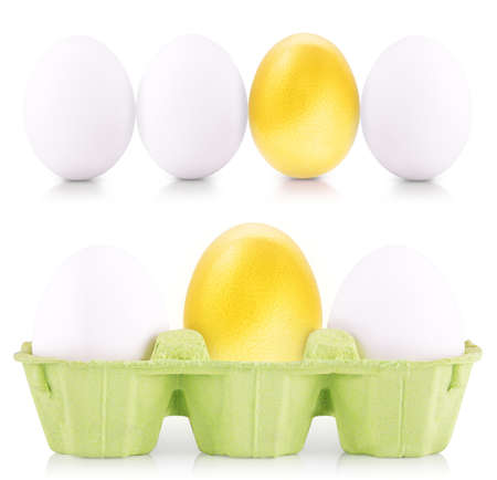 gold eggs: Success Symbol Concept of Easter white and gold eggs isolated on white
