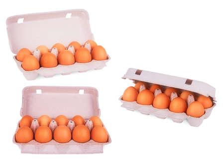 abreast: yellow eggs in box on a white background Stock Photo