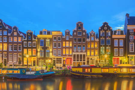 amstel: Amstel river, canals and night view of beautiful Amsterdam city. Netherlands