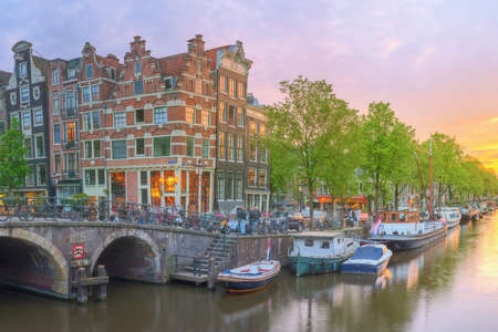 amstel: Amstel river, canals and night view of beautiful Amsterdam city. Netherlands.