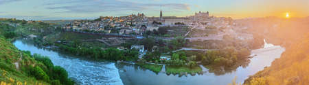 mancha: Panoramic view of ancient city and Alcazar on a hill over the Tagus River, Castilla la Mancha, Toledo, Spain.