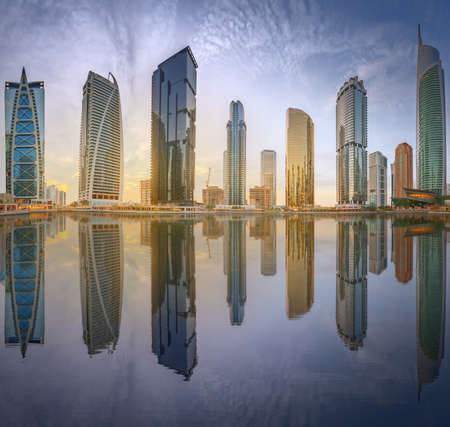 Panoramic view of Business bay and Lake Tower, reflection in a river, Dubai UAE. Stock fotó