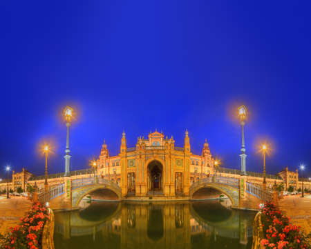 View of bridges and lights in Spain Square at evening, landmark in Renaissance Revival style, Seville, Spain.