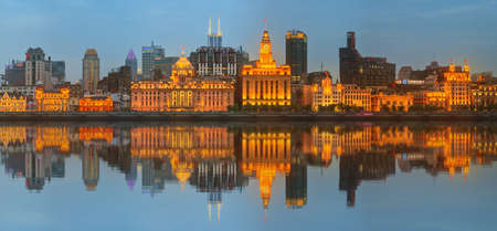 historical buildings: Skyline of The Bund, marvellous historical buildings and Huangpu River on sunset, Shanghai, China.