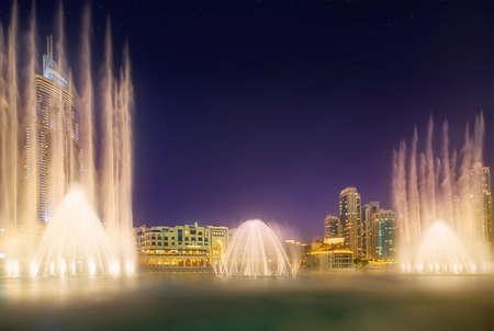 The night cityscape with dancing fountain of Dubai, UAE Stok Fotoğraf