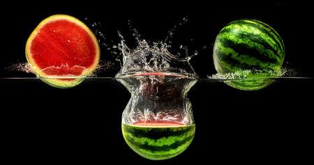 Fresh melon falling in water