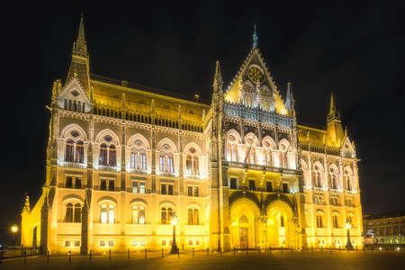Building of Hungarian Parliament on Danube river at night, Budapest