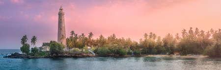 View of lighthouse Dondra and lights at sunset Matara, Sri Lanka