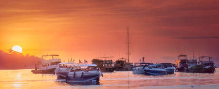 Seascape of sunset with boats on the sea