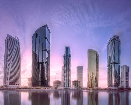 Jumeirah Lakes Towers in Dubai at purple sunrise Stock fotó