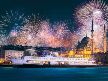 Beautiful fireworks above public ferry and old district of Istanbul Reklamní fotografie