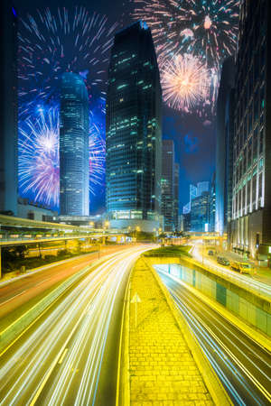 Beautiful fireworks above cities street of Hong Kong