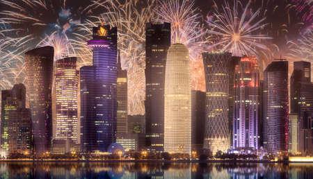 Beautiful fireworks above skyline of West Bay and Doha City, Qatar Standard-Bild