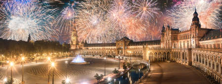 Beautiful fireworks above Spain Square on sunset, Seville Banco de Imagens - 112957216