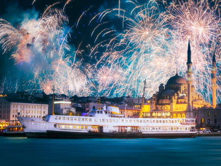 Beautiful fireworks above public ferry and old district of Istanbul Stock Photo