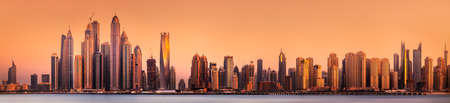 Modern buildings of Dubai Marina bay view from Palm Jumeirah during sunset, UAE