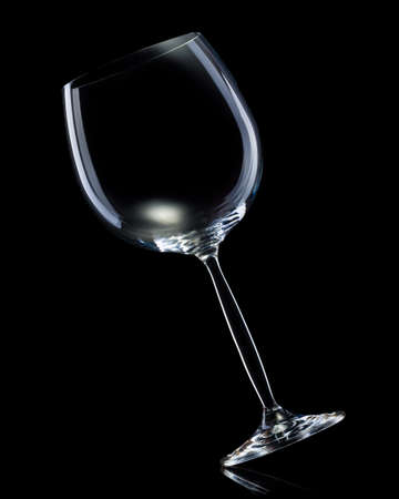 Empty glass for red wine isolated on black background.