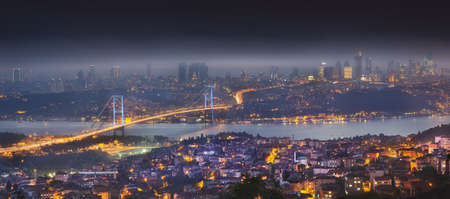 Night aerial view of Bosphorus bridge and panorama of Istanbul
