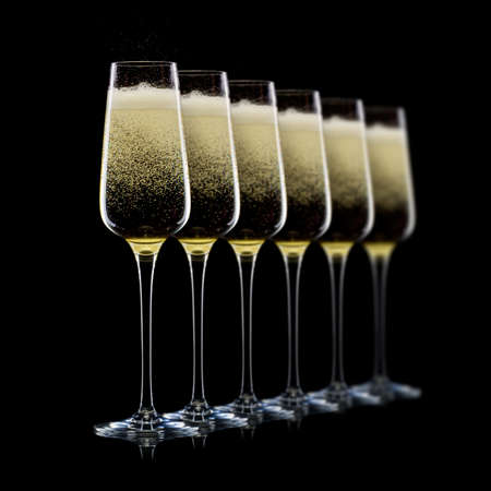 Set of luxury champagne glasses in a row isolated on a black Stock Photo