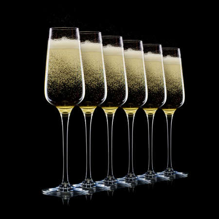 Set of luxury champagne glasses in a row isolated on a black