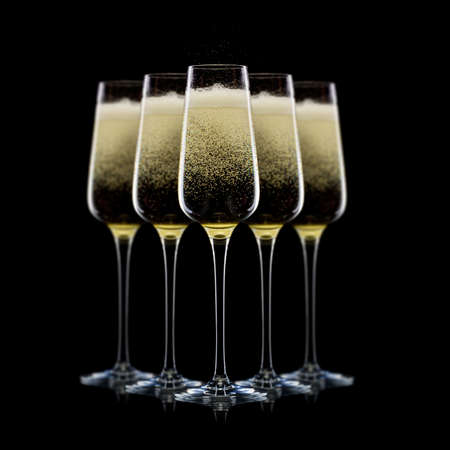 Set of luxury champagne glasses in a row isolated on a black Stockfoto