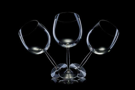 Set of empty glasses for red wine in a row isolated on black