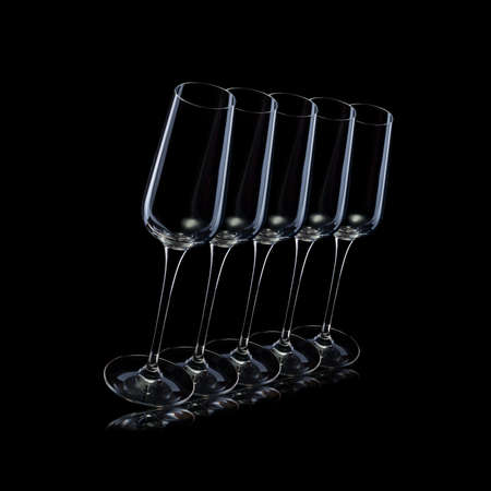 Set of empty luxury champagne glasses in a row isolated on a black