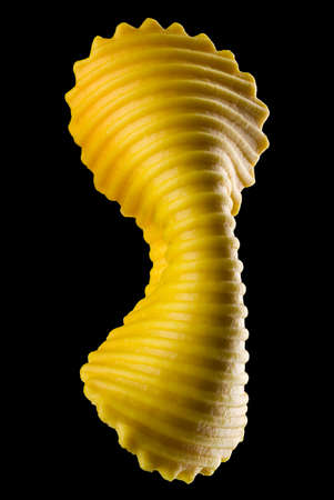 Yellow farfalle pasta isolated on black with clipping path