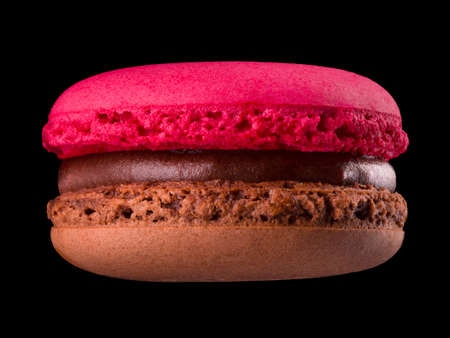 Macro photo of french chocolate macaroon or macaron isolated on black background Stock fotó