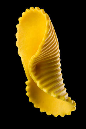 Yellow farfalle pasta isolated on black Stock fotó