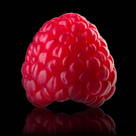 Raspberry with reflection and clipping path isolated on black