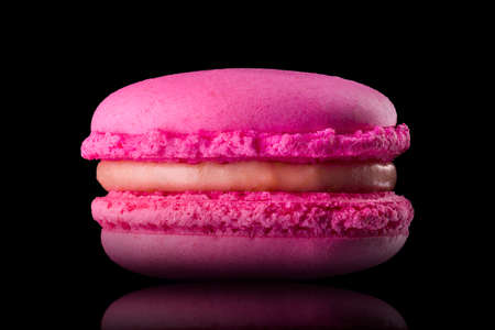 Macro photo of french pink rose macaroon isolated on black with clipping path Stock fotó