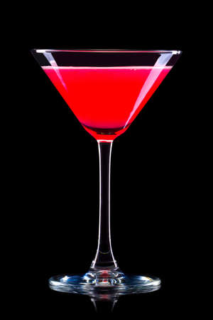 Strawberry margarita cocktail in martini glass isolated on black background