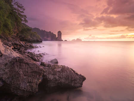 Beautiful sunset and dramatic clouds over the tropical island, Thailand. Vacation and background concept