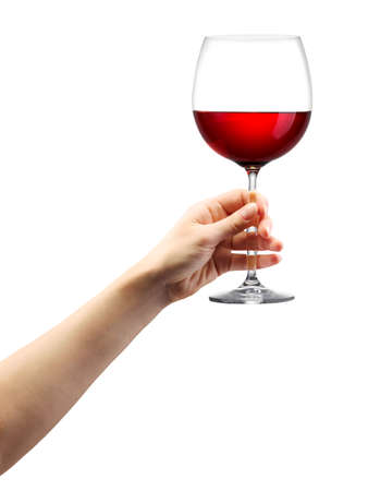 Woman hand holding red wine glass isolated on white background Foto de archivo