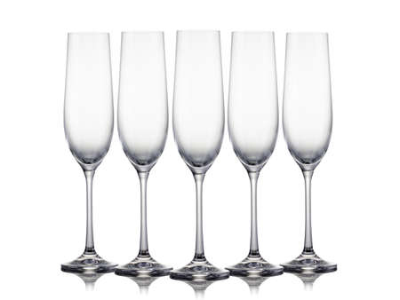 Set of empty champagne glasses in a row on a white background. Concept of winemaking and restaurant business Stock Photo