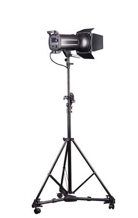 Photography studio flash on a lighting stand isolated on white