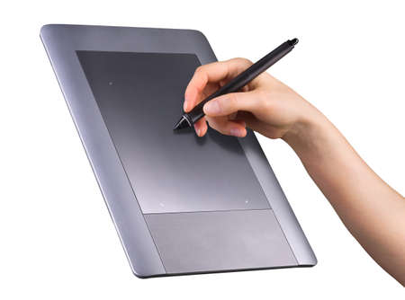 Hand holding digital graphic pen and drawing graphic tablet for illustrators, designers and photographers isolated on white background