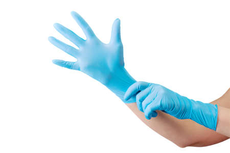 Doctor wearing a medical glove on hands isolated on white background . Concept of protection against pandemic and viruses.
