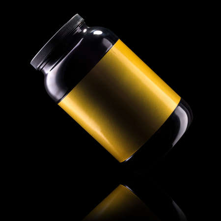 Sport nutrition like whey protein casein, bcaa, creatine plastic jar isolated on black background  . Concept of fitness supplement
