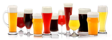 Set of fresh different beer glasses with bubble froth on white background.