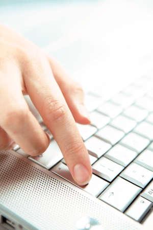Hand and computer. photo
