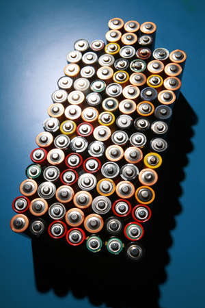 A composition of used batteries. photo