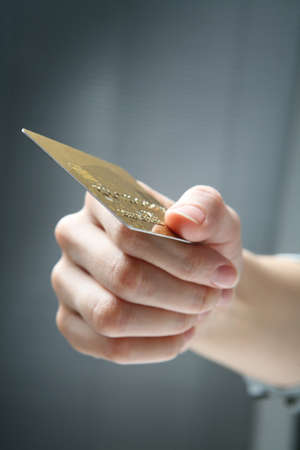 Hand holding credit card.  Stock Photo - 4331112