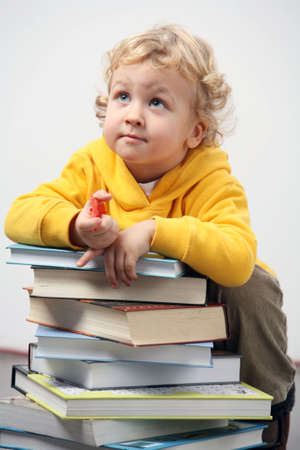Boy with books. Stock Photo - 4360607