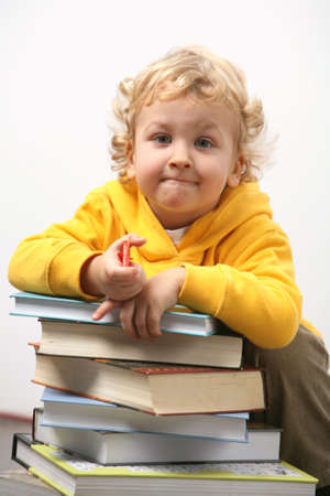 homestudy: Boy with books.