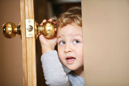 Kid open door. Stock Photo