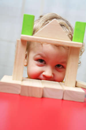 Boy playing with colorful wooden blocks. photo