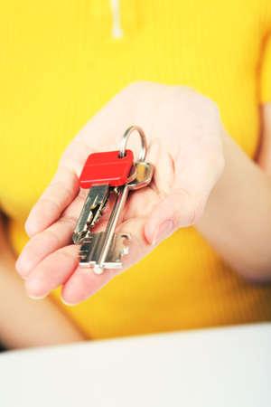 doorkey:  bunch of keys in womans hand